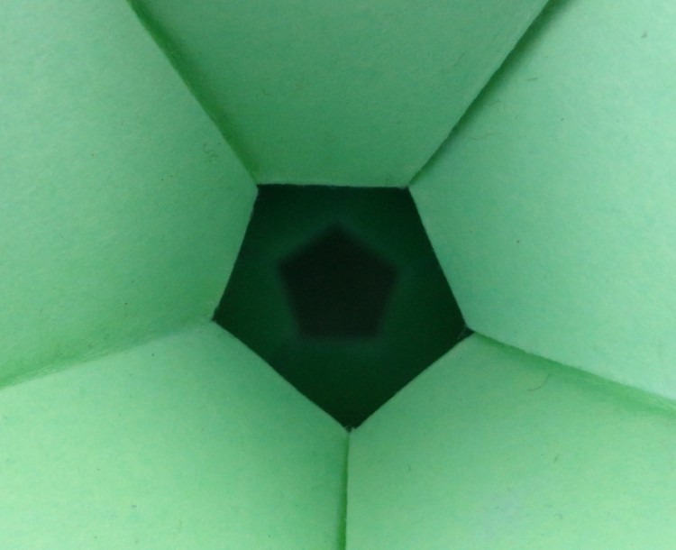 A closeup of this model reveals the matching pentagon on the other side